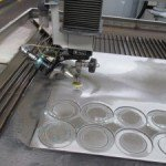 Water-jet cutting gaskets and shim rings